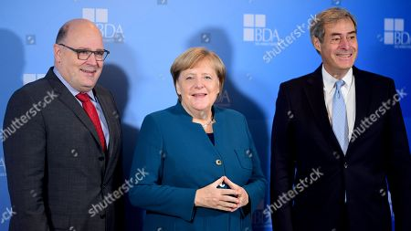 German Chancellor Angela Merkel (C), Confederation of German Employers? Associations (BDA) managing director Steffen Kampeter (L) and Confederation of German Employers? Associations (BDA) President Ingo Kramer pose for photographers at the Day of the Employers conference in Berlin, Germany, 12 November 2019. The Confederation of German Employers' Associations (BDA) is the umbrella organization of the German Industry.
