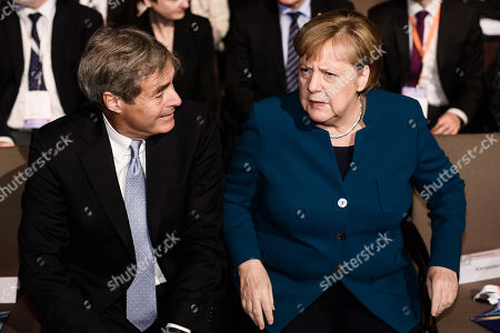 German Chancellor Angela Merkel (R) and Confederation of German Employers' Associations (BDA) President Ingo Kramer (L) talk during the Day of the Employers conference in Berlin, Germany, 12 November 2019. The Confederation of German Employers' Associations (BDA) is the umbrella organization of the German Industry.
