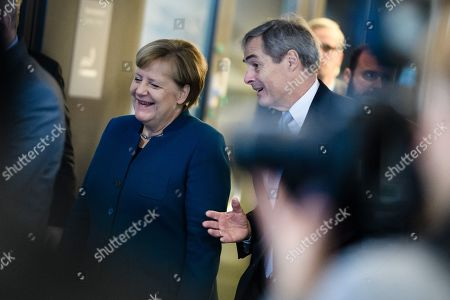 German Chancellor Angela Merkel (L) and Confederation of German Employers' Associations (BDA) President Ingo Kramer arrive for the Day of the Employers conference in Berlin, Germany, 12 November 2019. The Confederation of German Employers' Associations (BDA) is the umbrella organization of the German Industry.