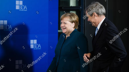 Stock Image of German Chancellor Angela Merkel (L) and Confederation of German Employers' Associations (BDA) President Ingo Kramer arrive for the Day of the Employers conference in Berlin, Germany, 12 November 2019. The Confederation of German Employers' Associations (BDA) is the umbrella organization of the German Industry.