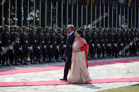 Abdul Hamid, Bidhya Devi Bhandari. Bangladesh President Abdul Hamid, walks with Nepalese president Bidhya Devi Bhandari, right, to inspect a joint military guard of honor as he arrives for an official 4-day visit at the Tribhuwan International airport in Kathmandu, Nepal