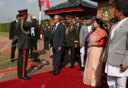 Stock Image of Purna Chandra Thapa, Abdul Hamid, Bidhya Devi Bhandari. Nepalese Army chief Purna Chandra Thapa, left salutes Bangladesh President Abdul Hamid, as Nepalese president Bidhya Devi Bhandari, right looks on as he arrives for an official 4-day visit at the Tribhuwan International airport in Kathmandu, Nepal