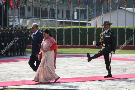 Bidhya Devi Bhandari, Abdul Hamid. Bangladesh President Abdul Hamid, walks with Nepalese president Bidhya Devi Bhandari, front to inspect a joint military guard of honor as he arrives for an official 4-day visit at the Tribhuwan International airport in Kathmandu, Nepal