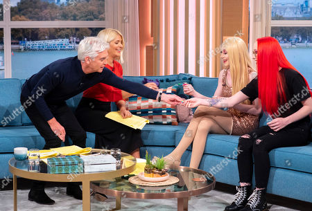 Phillip Schofield and Holly Willoughby with Lewis Bailey and his sister Mariah