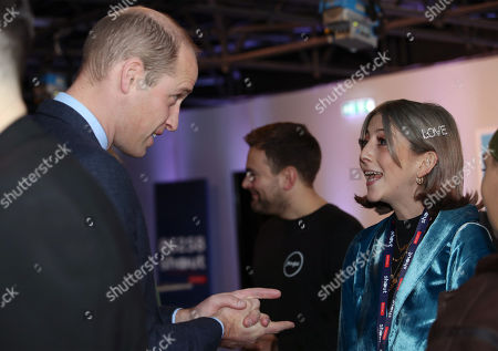 Prince William meets Scarlett Curtis, the daughter of Richard Curtis, during a volunteer celebration event with the charity Shout at the Troubadour White City Theatre in London.