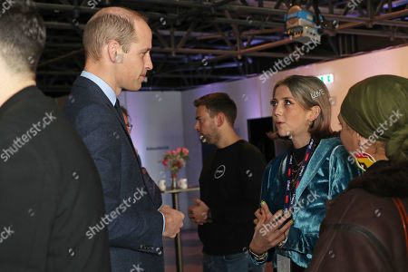 Prince William meets Scarlett Curtis, the daughter of Richard Curtis, during a volunteer celebration event with the charity Shout at the Troubadour White City Theatre in London