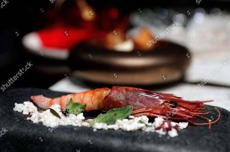 Stock Picture of A view of a shrimp tapa cooked by Spanish chefs Quique Dacosta, Joan Roca and Angel Leon during the 'Gastronoma' gastronomic fair in Valencia, Spain, 12 November 2019. The gastronomic fair, which ends 12 November 2019, gathered 40 Michelin starred chefs.