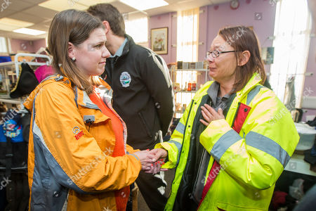 Liberal Democrat leader Jo Swinson meets an emotional Rosie Squires from Stainforth while visiting Stainforth in Yorkshire today to meet people affected by recent flooding. Jo is meeting the organisers of the charity Stainforth4All & helping to sort clothing.