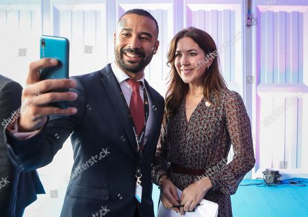 Danish Crown Princess Mary (R) poses for a selfie photo with a delegate during a side event after the official opening of the Nairobi Summit on International Conference on Population and Development (ICPD25), in Nairobi, ?Kenya, 12 November 2019. The summit takes place from 12 to 14 November.