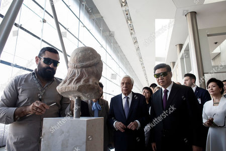 Chinese President Xi Jinping (R) accompanied by Greek President Prokopis Pavlopoulos (C)  is briefed by archaeologists on the Acropolis's sculptures restoration during a visit to the Acropolis Museum in Athens, Greece, 12 November 2019. Chinese President Xi Jinping concluded his two-day official visit to Greece. 'Not only do I agree that the Parthenon Sculptures should be returned but you will have our support, because we also have many of our own artifacts from Chinese civilisation that are outside the country and that we are trying to bring back home,' stated visiting Chinese President Xi Jinping to President of the Hellenic Republic Prokopios Pavlopoulos, during their visit to the Acropolis Museum.