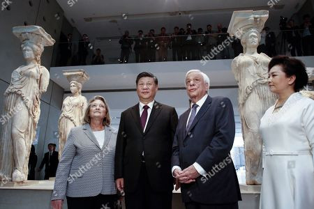 Stock Photo of Greek President Prokopis Pavlopoulos (2-R), Chinese President Xi Jinping (2-L) and their wives Peng Liyuan (R) and Vlasia Pavlopoulou- Peltsemi (L) in front of the Caryatids during a visit to the Acropolis Museum in Athens, Greece, 12 November 2019. Chinese President Xi Jinping concluded his two-day official visit to Greece. 'Not only do I agree that the Parthenon Sculptures should be returned but you will have our support, because we also have many of our own artifacts from Chinese civilisation that are outside the country and that we are trying to bring back home,' stated visiting Chinese President Xi Jinping to President of the Hellenic Republic Prokopios Pavlopoulos, during their visit to the Acropolis Museum.