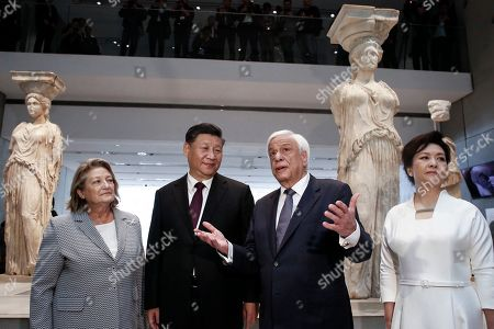 Stock Image of Greek President Prokopis Pavlopoulos (2-R), Chinese President Xi Jinping (2-L) and their wives Peng Liyuan (R) and Vlasia Pavlopoulou- Peltsemi (L) speak in front of the Caryatids in the Acropolis Museum in Athens, Greece, 12 November 2019. Chinese President Xi Jinping concluded his two-day official visit to Greece. 'Not only do I agree that the Parthenon Sculptures should be returned but you will have our support, because we also have many of our own artifacts from Chinese civilisation that are outside the country and that we are trying to bring back home,' stated visiting Chinese President Xi Jinping to President of the Hellenic Republic Prokopios Pavlopoulos, during their visit to the Acropolis Museum.