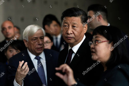 Stock Picture of Chinese President Xi Jinping (2-R) is briefed by Greek President Prokopis Pavlopoulos (L) during a visit to the Acropolis Museum in Athens, Greece, 12 November 2019. Chinese President Xi Jinping concluded his two-day official visit to Greece. 'Not only do I agree that the Parthenon Sculptures should be returned but you will have our support, because we also have many of our own artifacts from Chinese civilisation that are outside the country and that we are trying to bring back home,' stated visiting Chinese President Xi Jinping to President of the Hellenic Republic Prokopios Pavlopoulos, during their visit to the Acropolis Museum.