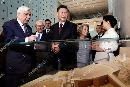Chinese President Xi Jinping (C) accompanied by Greek President Prokopis Pavlopoulos (L) visits the Acropolis Museum in Athens, Greece, 12, November, 2019. Chinese President Xi Jinping concluded his two-day official visit to Greece. 'Not only do I agree that the Parthenon Sculptures should be returned but you will have our support, because we also have many of our own artifacts from Chinese civilisation that are outside the country and that we are trying to bring back home,' stated visiting Chinese President Xi Jinping to President of the Hellenic Republic Prokopios Pavlopoulos, during their visit to the Acropolis Museum.