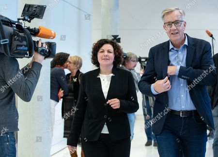Stock Photo of New German The Left (Die Linke) party faction co-chairwoman in the German parliament Bundestag Amira Mohamed Ali (L) and co-chairman Dietmar Bartsch (R) walk prior to a press statement in Berlin, Germany, 12 November 2019. As Sahra Wagenknecht resigns her position as co-chairwoman of the faction, the party decideed Amira Mohamed Ali as a future faction leader.