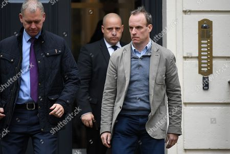 British Foreign Secretary Dominic Raab (R) departs the Conservative Party headquarters in London, Britain, 12 November 2019.  Key ministers are to hold an emergency Cobra meeting to discuss the floods that have devastated regions in northern England.