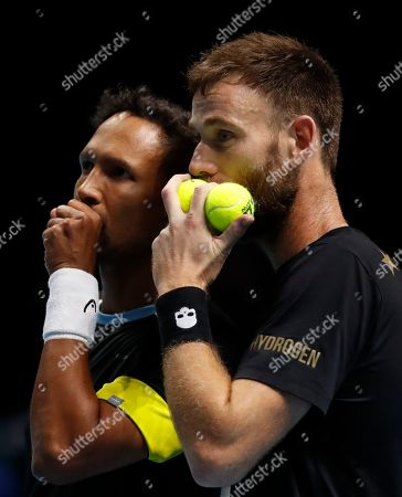 Raven Klaasen of South Africa, left, and Michael Venus of New Zealand talks tactics prior to serving to Lukasz Kubot of Poland and Marcelo Melo of Brazil during their ATP World Tour Finals doubles tennis match at the O2 Arena in London