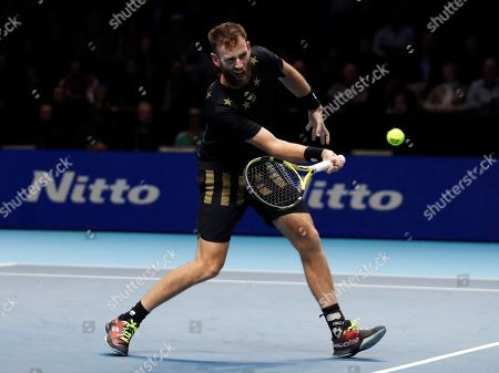 Michael Venus of New Zealand hits a return to Lukasz Kubot of Poland and Marcelo Melo of Brazil during their ATP World Tour Finals doubles tennis match at the O2 Arena in London, .Venus is partnered with Raven Klaasen of South Africa