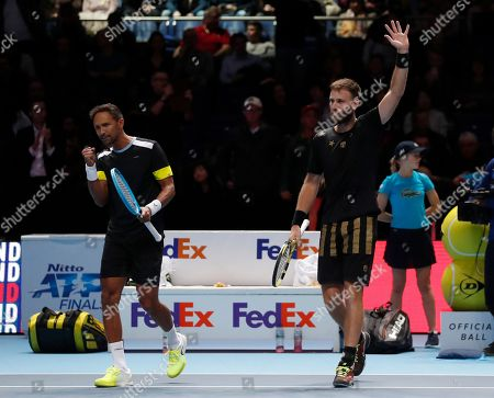 Raven Klaasen of South Africa, left, and Michael Venus of New Zealand celebrate after defeating Lukasz Kubot of Poland and Marcelo Melo of Brazil in their ATP World Tour Finals doubles tennis match at the O2 Arena in London