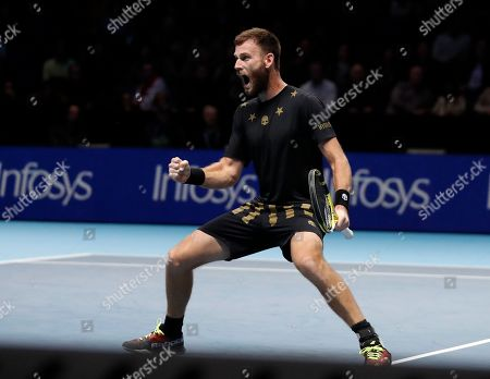 Stock Picture of Michael Venus of New Zealand celebrates after winning a point against Lukasz Kubot of Poland and Marcelo Melo of Brazil during their ATP World Tour Finals doubles tennis match at the O2 Arena in London, . Venus is partnered with Raven Klaasen of South Africa