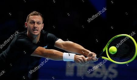 Filip Polasek of Slovakia plays a retrun to Rajeev Ram of the United States and Joe Salisbury of Britain during their ATP World Tour Finals doubles tennis match at the O2 Arena in London, . Filip Polasek of Slovakia is partnered with Ivan Dodig of Croatia