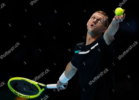 Filip Polasek of Slovakia serves to Rajeev Ram of the United States and Joe Salisbury of Britain during their ATP World Tour Finals doubles tennis match at the O2 Arena in London, . Filip Polasek of Slovakia is partnered with Ivan Dodig of Croatia