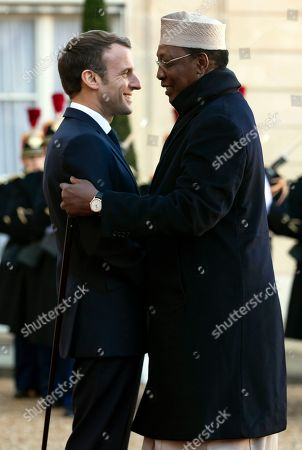 Stock Photo of French President Emmanuel Macron (L) greets Tchad's president Idriss Deby (R) for a meeting as part of the Paris Peace Forum, at the Elysee Palace in Paris, France, 12 November 2019. The international event on global governance issues and multilateralism takes place from 12 to 13 November in Paris.