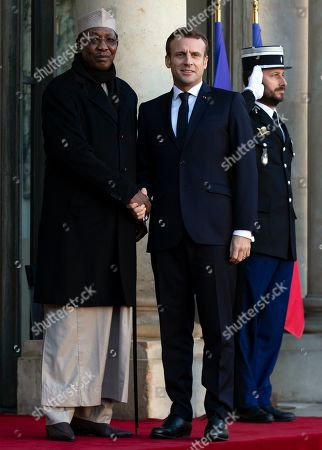 French President Emmanuel Macron (R) greets Tchad's president Idriss Deby (L) for a meeting as part of the Paris Peace Forum, at the Elysee Palace in Paris, France, 12 November 2019. The international event on global governance issues and multilateralism takes place from 12 to 13 November in Paris.