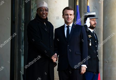 Stock Picture of French President Emmanuel Macron (R) greets Tchad's president Idriss Deby (L) for a meeting as part of the Paris Peace Forum, at the Elysee Palace in Paris, France, 12 November 2019. The international event on global governance issues and multilateralism takes place from 12 to 13 November in Paris.