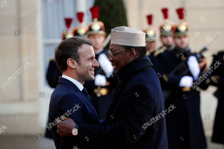 French President Emmanuel Macron welcomes Chad's President Idriss Deby prior to their meeting at the Elysee Palace, in Paris