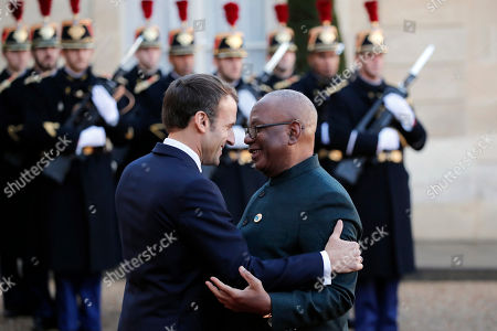 French President Emmanuel Macron welcomes Mali's President Ibrahim Boubacar Keita prior to their meeting at the Elysee Palace, in Paris