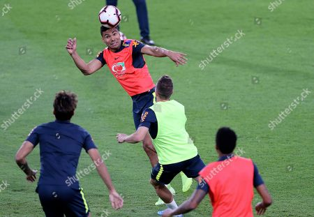 Stock Image of Brazil's Carlos Casimiro heads the ball during a practice session in Abu Dhabi, United Arab Emirates, . Brazil will play a friendly match against South Korea on Nov. 19th