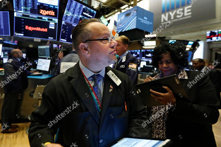 Trader Robert Arciero works on the floor of the New York Stock Exchange, . Stocks are opening slightly higher on Wall Street, led by gains in technology and health care companies