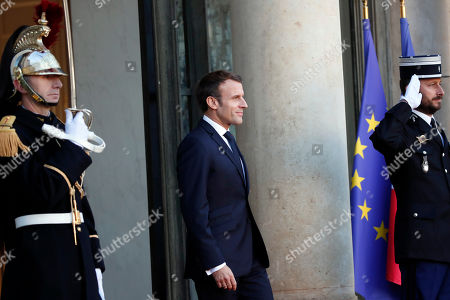 French President Emmanuel Macron arrives to welcome Mali's President Ibrahim Boubacar Keita prior to their meeting at the Elysee Palace, in Paris