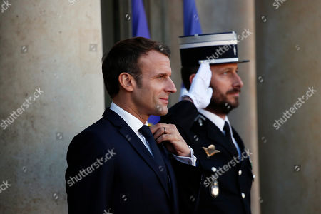 French President Emmanuel Macron waits to welcome Mali's President Ibrahim Boubacar Keita prior to their meeting at the Elysee Palace, in Paris