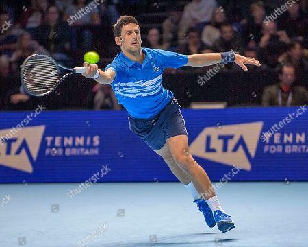 Novak Djokovic (SRB) in action in the Bjorn Borg group stage match between Novak Djokovic (SRB) (2) and Dominic Thiem (AUT) (5).