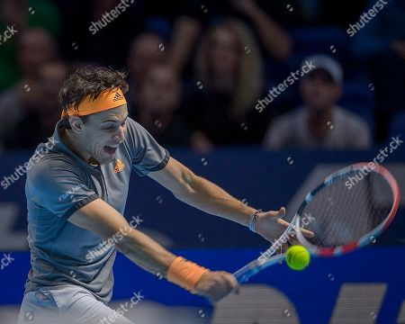 Dominic Thiem (AUT) in action in the Bjorn Borg group stage match between Novak Djokovic (SRB) (2) and Dominic Thiem (AUT) (5).