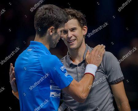 Novak Djokovic (SRB) congratulates Dominic Thiem (AUT) after their Bjorn Borg group stage match.