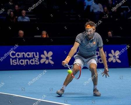 Stock Photo of Dominic Thiem (AUT) in action during the Bjorn Borg group stage match between Novak Djokovic (SRB) (2) and Dominic Thiem (AUT) (5).