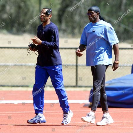Gb (great Britain) Athletics Training Camp For The Sydney Summer Olympic Games On The Gold Coast Of Australia. Lindford Christie Met Up With Some Of The Athletes Including Dwain Chambers Christian Malcolm Darren Campbell And Katharine Merry And Even Took Part In Some Fun Racing... Lindford Christie Trains With Darren Campbell (wearing A Walkman).