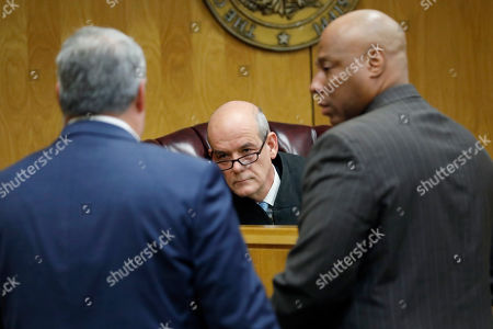 Dee Bates, Kelsey L. Rushing, Mike Taylor. Lincoln County Circuit Court Judge Mike Taylor, center, listens as District Attorney Dee Bates, left, and Kelsey L. Rushing, a staff attorney with the Office of State Public Defender, Capital Litigation Division, confer during a court appearance by Marquis Flowers, unseen, who pleaded not guilty to capital murder charges of two policemen, . Cpl. Zach Moak and Patrolman James White of the Brookhaven Police Department were shot to death Sept. 29, 2018
