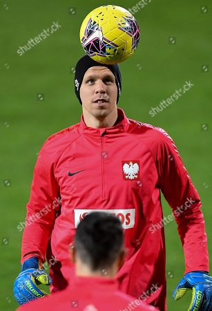 Polish national soccer team goalkeeper Wojciech Szczesny warms up during his team's training session in Warsaw, Poland, 12 November 2019. Poland will face Israel on 16 November and Slovenia on 19 November 2019 in their UEFA EURO 2020 qualifying soccer matches.