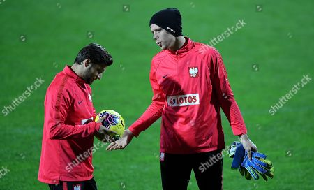 Polish national soccer team player Bartosz Bereszynski (L) and goalkeeper Wojciech Szczesny (R) warm-up during their team's training session in Warsaw, Poland, 12 November 2019. Poland will face Israel on 16 November and Slovenia on 19 November 2019 in their UEFA EURO 2020 qualifying soccer matches.