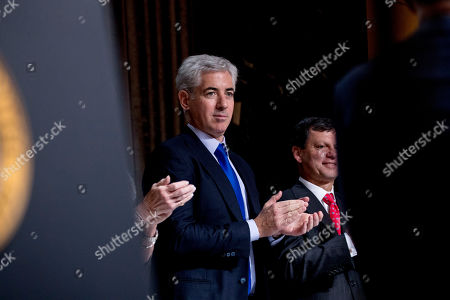 Billionaire investor William Ackman applauds as President Donald Trump appears to speak at the Economic Club of New York at the New York Hilton Midtown in New York