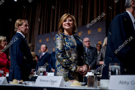Journalist Maria Bartiromo, center, appears before President Donald Trump speaks at the Economic Club of New York at the New York Hilton Midtown in New York