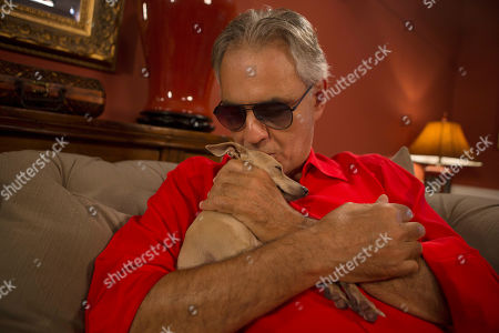 "This photo shows Italian tenor Andrea Bocelli with his dog Katarina during an interview at his home in North Miami, Fla. Bocelli is defending opera legend Placido Domingo and calling it ""absurd"" that opera houses have canceled the star's performances before sexual harassment allegations against him are fully investigated. Three U.S. music companies canceled Domingo appearances following allegations of sexual harassment made by multiple women earlier this year"
