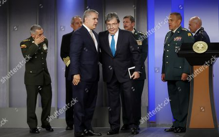 New Colombian Defence Minister Carlos Holmes Trujillo (C-R) speaks with Colombian President Ivan Duque (L) during a ceremony at the Palacio Nariño, in Bogota, Colombia, 12 November 2019. President Ivan Duque appointed the Foreign Minister Carlos Holmes Trujillo as the new Defence minister upon the resignation of Guillermo Botero.