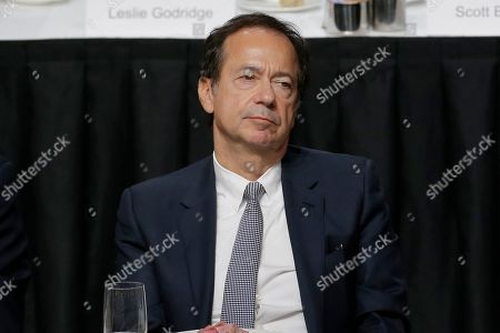Stock Picture of John Paulson listens while President Donald Trump speaks during a meeting of the Economic Club of New York in New York