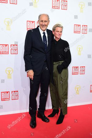 German racing driver legend Hans-Joachim Stuck (L) and Uschi Schnitzer attend the awarding ceremony of 'Das Goldene Lenkrad' (lit. the Golden Steering Wheel) in Berlin, Germany, 12 November 2019. For the 43rd time, the weekly 'BILD am SONNTAG' and the European AUTO BILD Group award the Europe's most important car prize - 'The Golden Steering Wheel'.
