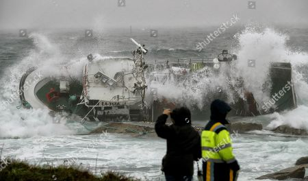 A view of the ship 'Divina del Mar' during a heavy sea storm in Porto do Son, A Coruna, northeast Spain, 12 November 2019. A sailor from the 'Divina del Mar' died after the ship run aground near the Castro de Barona settlement. Local rescue teams where unable to reach the boat due to the extreme weather conditions.